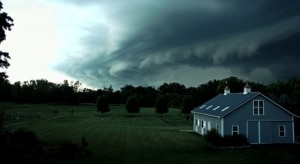 Stormy weather above farm house during emergency alerts