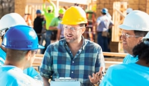 Construction manager at work doing employee check-ins